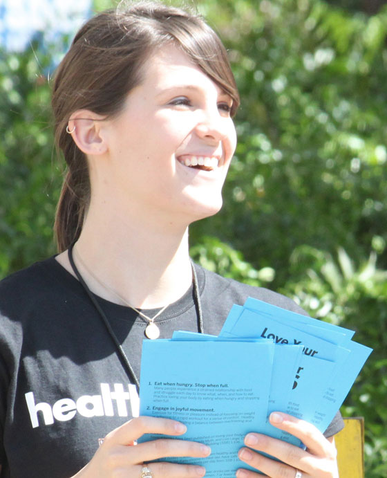 Volunteer giving out pamphlets